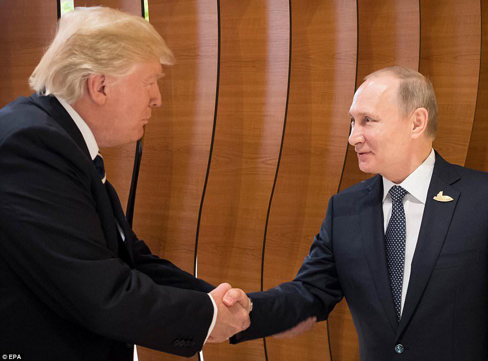 redwire-singapore-trump-putin-handshake
