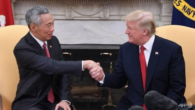 redwire-singaproe-trump-lee-hsien-loong-handshake